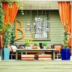 Patio decor. favorite-places-and-spaces. Look at the picture frames and that huge letter!!!