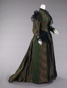 Dress  Mme. Uoll Gross.   Date: 1889. Culture: American. Medium: silk, metal. Dimensions: Length at CB: 70 in. (177.8 cm).