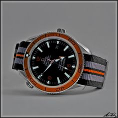 Omega Seamaster on textile strap. Now I have a reason to buy this strap. Love my Seamaster.