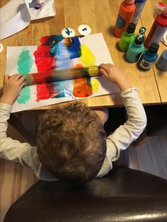 Rolling pin painting for kids. My eldest loved seeing the colours spread and merge together.