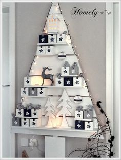 Another 'wall' Christmas Tree using those clever magazine racks from IKEA.... could be redecorated for each season or event - brilliant!