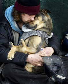 A homeless man sleeps in the arms of his dog on Queen St. W. in Toronto, on a freezing day in November, 2006. This photo was runner-up in the Feature category at Sun Media's 2007 Dunlop Awards. Veronica Henri/Toronto Sun