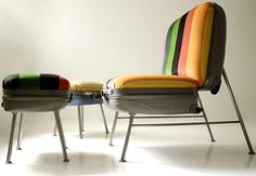 Upholstered suitcase chair and ottoman.