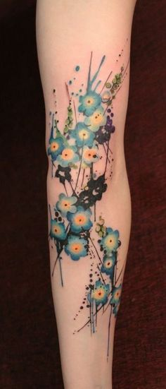 Beautiful little blue flowers watercolor tattoo on leg for girls