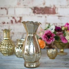 Get tall glass vases for your DIY vintage wedding centerpieces like this gorgeous gold mercury glass Carraway vase. Perfect to decorate your home or to create rustic glam floral arrangements, this gold glass vase makes a stunning design!