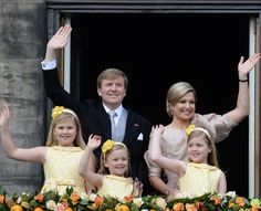 Emotions run high as King Willem-Alexander and Queen Maxima appear with adorable daughters on the palace balcony  30 APRIL 2013