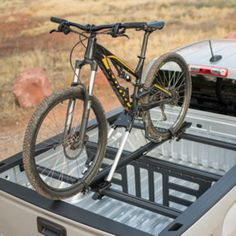 Roof-Mounted Big Mouth™ Bicycle Carrier in Black by Thule® - Associated Accessories Truck Bed Bike Rack, Gmc Canyon, Bicycle Accessories, Cadillac, Mountain Biking, Oem, Chevrolet, Trucks, Brand New