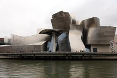 Built by Frank Gehry in Bilbo, Spain with date 1997. Images by Gehry Partners. Set on the edge of the Nervión River in Bilbao‭, ‬Spain, the Guggenheim Museum is a fusion of complex‭, ‬swirling for...