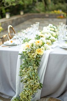 We love this pale blue and citrus wedding. The sunset reception, vineyard cocktail hour, and secret garden style venue are leaving us breathless. Carnation Wedding, Yellow Wedding Flowers, Yellow Flowers, Floral Wedding, Wedding Greenery, Wedding Reception Centerpieces, Reception Decorations, Flower Decorations, Reception Table