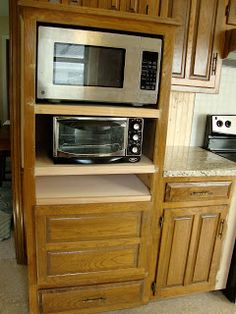 remove double oven, add more storage space.  replace drop-in stove w/ a slide-in stove/oven unit.
