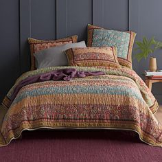 This paisley and floral patchwork quilt radiates warmth in a spectrum of gorgeous color—from ochre, terracotta, and rust to olive, Bordeaux, and chocolate. The Company Store King Size Blanket, King Size Quilt, Cheap Quilts, Outdoor Cushions And Pillows, Home Decor Sale, The Company Store, Bedding Shop, Quilt Sets, Cotton Bedding