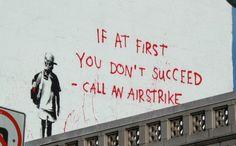Airstrike_Banksy_Graffiti_by_tacomango.jpg