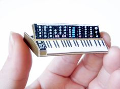 Wouldn't your synthesizer-loving sweetheart look handsome with this on his lapel? I know mine would.