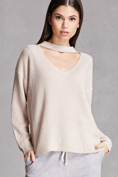 A ribbed knit sweater featuring a choker neckline with a V-cutout, long sleeves, and a billowy silhouette. This is an independent brand and not a Forever 21 branded item.