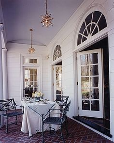 curved windows and french doors