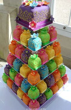 This cake was made by the Rachel Hill of Planet Cake. Beautiful colors and intricate designs cover the mini wedding cakes in six tiers. This unusual wedding cake was made for a couple for their Indian Bollywood wedding.better than cupcakes. Pretty Cakes, Cute Cakes, Beautiful Cakes, Amazing Cakes, Sweet Cakes, Fancy Cakes, Mini Cakes, Cupcake Cakes, Cupcake Tree