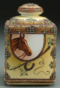 A NIPPON HORSE PORTRAIT PORCELAIN HUMIDOR CIRCA 1900 WITH TRANSER SCENE AND MORIAGE DECORATED SCROLLS