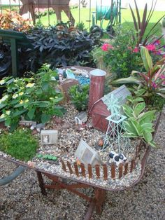 An old wheelbarrow makes a great fairy garden. You can move it where ever you want!