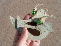 Two rustic bird ornaments made out of birch bark by BirchBarkBeads, $8.00