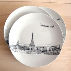 City skyline plates (choice of 5 cities) with your own name or message in the plane's banner! Set of 4 dessert plates.