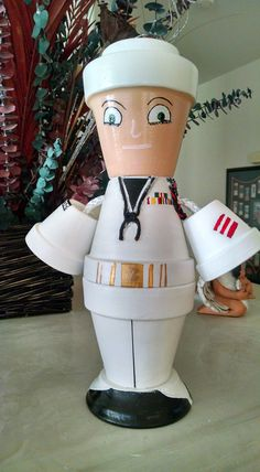 Greetings from our United States Navy Sailor. Navy Sailor is looking for a new home where he can complement other military memorabilia. You can assign Navy Sailor whatever rank you wish as well as his uniform style. In the photo he is wearing dress whites as he prepares for a Change of Command ceremony. Navy Sailor cant wait to meet you, we just know you will love him.   * Height (Head to toes): ~12-13 inches (Also available in tall and short sizes. Can be designed with or without separate…