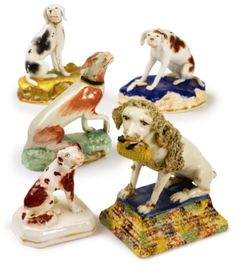 A GROUP OF THREE STAFFORDSHIRE PORCELAIN FIGURES OF SEATED DOGS 19TH CENTURY - Sotheby's (Brooke Astor estate)