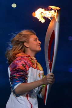 Maria Sharapova carrying the Olympic torch into the Sochi 2014 Winter Games