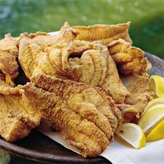 fried catfish...an outside old fashion fish fry with french fries, hushpuppies and cole slaw!