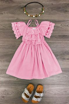 These dresses are simply stunning! Gorgeous pink dress with lace on the sleeves. Dressy enough for any event, photoshoot, but still comfy enough for everyday wear! This is a must have for any princesses wardrobe, grab one today these will go fast! SIZING: Runs true to size, but if you are between sizes we recommend siz