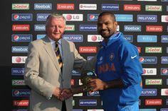 Shikhar Dhawan of India is presented with the Man of the Match award by David Morgan (L) during the ICC Champions Trophy group B match between India and South Africa at Cardiff Stadium on June 6, 2013 in Cardiff, Wales.
