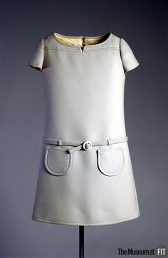 Courreges light grey wool dress,1968 , France.  Courrèges, used the future as a metaphor for youth. Famous for Space Age designs and futuristic garments in crisp fabrics. Museum at FIT New York.