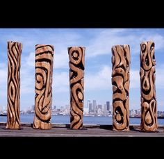 """The five totems of Steven Jensen's """"Fish Tales"""" stand proudly in front of the Seattle Court House in the state of Washington."""