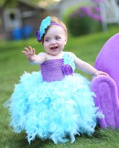 Hey, I found this really awesome Etsy listing at https://www.etsy.com/listing/198803894/purple-and-aqua-blue-feather-tutu-dress