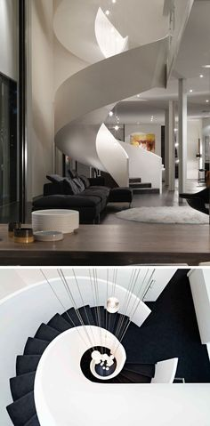 The stairs of this grand spiral staircase are covered in a black carpet that contrasts the white throughout the modern house and makes them that much more dramatic.