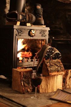 Cabin life - multitasking... drying your boots whilst enjoying a glass of red
