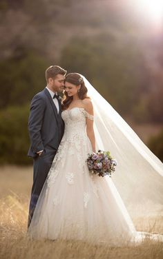 Essense of Australia #D2605 - This lace ballgown from Essense of Australia features a sweetheart neckline, accented on either side by drapey, lace off-the-shoulder straps.