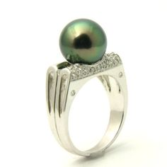 Black Tahitian Pearl & Diamond Engagement Ring - Here's an unusual shank custom designed for this Black Tahitian Pearl & Diamond Engagement Ring stamped in 18k White Gold featuring a Mystic Topaz Tahitian Pearl set on the top of the ring surrounded by some additional White Round accent stones on the top of the shank. This Black Tahitian Pearl ring is 10.6mm in diameter & the total gem weight is equal to .15 carats. #unusualengagementrings