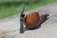 Hand forged pipe tamper.