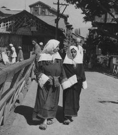 Two women walking through the streets of Srinagar in Kashmir. (Photo by Keystone Features/Getty Images) Kashmir India, Srinagar, Madhya Pradesh, Paradise On Earth, Eid Mubarak, Heaven On Earth, Walks, Nostalgia, Black And White