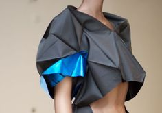 The project is the work of Japanese fashion designer Issey Miyake's Reality Lab, a research and development team formed by Miyake. They worked with origami inventor and computer scientist Jun Mitani, who created a computer program to construct three-dimensional structures from a single piece of paper.  www.isseymiyake.com    Design: Miyake Design Studio