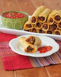These baked Spicy Beef Taquitos are perfect football party food or great for Taco Tuesday! Only 98 calories or 2 Weight Watchers points each! www.emilybites.com #healthy