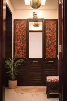 For Indira, it is her love of blockprints and fabric that inspired her to add them to her doors and cabinets, making for a truly beautiful outcome. | Home Tour: A beautiful Antique Modern home in Bangalore ~ The Keybunch Decor Blog Kalamkari Fabric, Brick Cladding, Vintage Trunks, Tanjore Painting, Entry Way Design, Makes You Beautiful, Stone Flooring, Decorating Blogs, Fabric Art