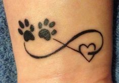 10 Most Beautiful Pet Memorial Tattoos - A minimalist pet memorial tattoo combines the symbol for infinity with two paw prints and a heart. Small Dog Tattoos, Memorial Tattoos Small, Infinity Tattoo Designs, Infinity Tattoos, Heart With Infinity Tattoo, Body Art Tattoos, Print Tattoos, Cool Tattoos, Paw Tattoos
