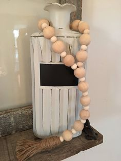 A personal favorite from my Etsy shop https://www.etsy.com/listing/508876268/wood-bead-garland-farmhouse-beads-jar