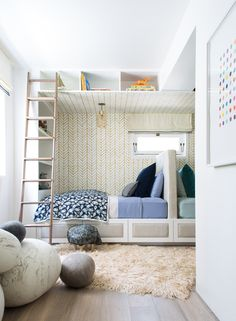 Fun children's room with a ladder and colorful linens