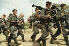 Color print of advancing German infantry in the opening phase of the invasion of Russia, June-July 1941. Although color had yet to become mainstream, German army photographers experimented extensively with the new film. Its higher price and more elaborate development prevented its widespread use, yet many such early color prints are available today.
