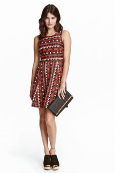 Sleeveless dress: Short, sleeveless dress in sturdy jersey with a wrapover back with a decorative opening and a seam at the waist with a gently flared skirt.