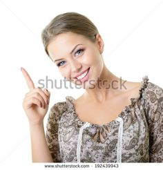 Beautiful happy smiling woman pointing up with her finger at copyspace, isolated over white - stock photo