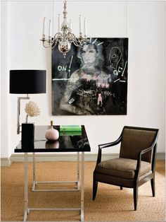 White walls + glossy black desk + sexy arm chair + chrome chandelier + edgy art