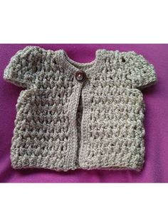 Free Crochet Pattern Download -- This Crocheted Doll Cardigan, designed by Robyn Chachula, is featured in episode 3, season 2 of Knit and Crochet Now! TV. Learn more here: https://www.anniescatalog.com/knitandcrochetnow/patterns/detail.html?pattern_id=115&series=2